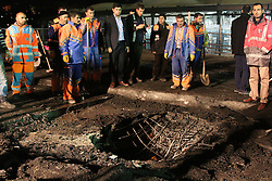 People look on the hole caused by the explosion near Besiktas' Vodafone Arena Stadium in Istanbul, Turkey, December 11, 2016. At least 38 people died on December 10 when an explosion occurred near Besiktass Vodafone Arena, Interior Minister Suleyman Soylu has announced. Photo by DHA/Depo Photos/ABACAPRESS.COM