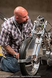 Brian Buttera checking out Alp Sungurtekin's LSR Triumph at the Handbuilt Show. Austin, TX. USA. Friday April 20, 2018. Photography ©2018 Michael Lichter.