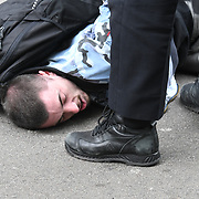 London March 20th 2021 , Police pin down a man he shouting in pain. 2021-03-20