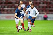 Liam Smith (#2) Scotland U21s (Ayr United) and Ryan Sessegnon (#11) of England U21s (Fulham) during the U21 UEFA EUROPEAN CHAMPIONSHIPS match between Scotland and England at Tynecastle Stadium, Edinburgh, Scotland on 16 October 2018.