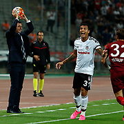 Besiktas's Ramon Motta (M) and Trabzonspor's headcoach Shota Arveladze (L), Yusuf Erdogan (R) during their Turkish Super League soccer derby match Besiktas between Trabzonspor at the Ataturk Olimpiyat stadium in Istanbul Turkey on Saturday, 22 August 2015. Photo by Aykut AKICI/TURKPIX