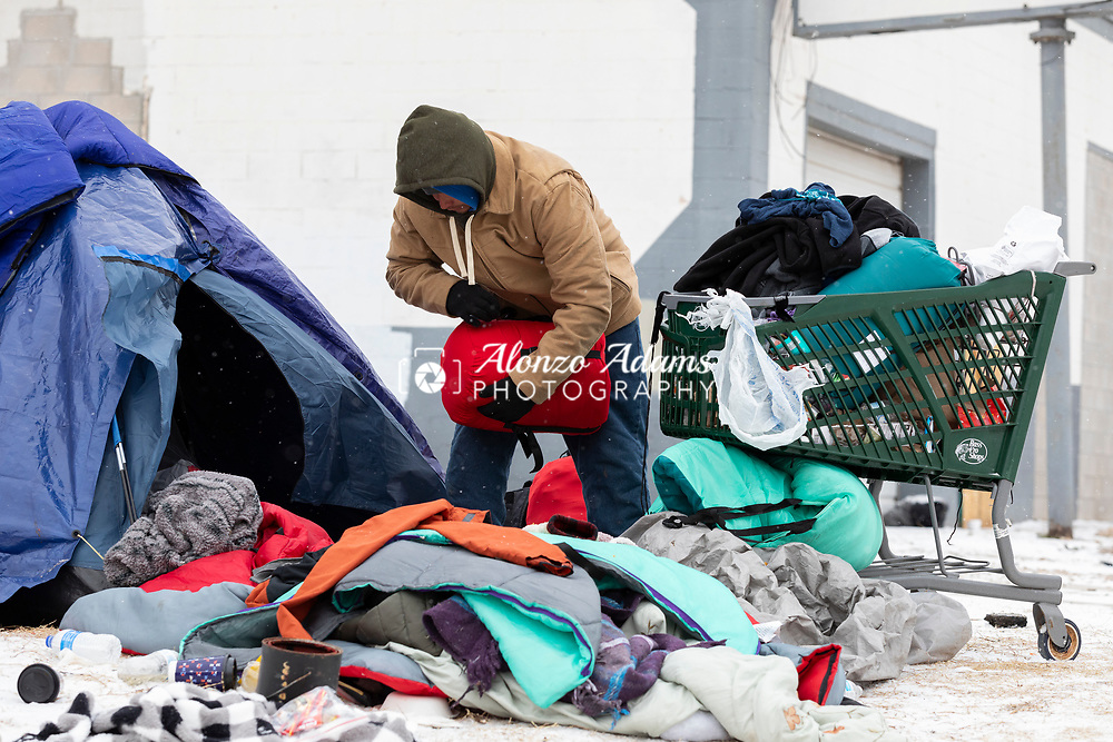 Homeless in the freezing cold and snow in Oklahoma City on Friday, February 12, 2021. Photo copyright © 2021 Alonzo J. Adams
