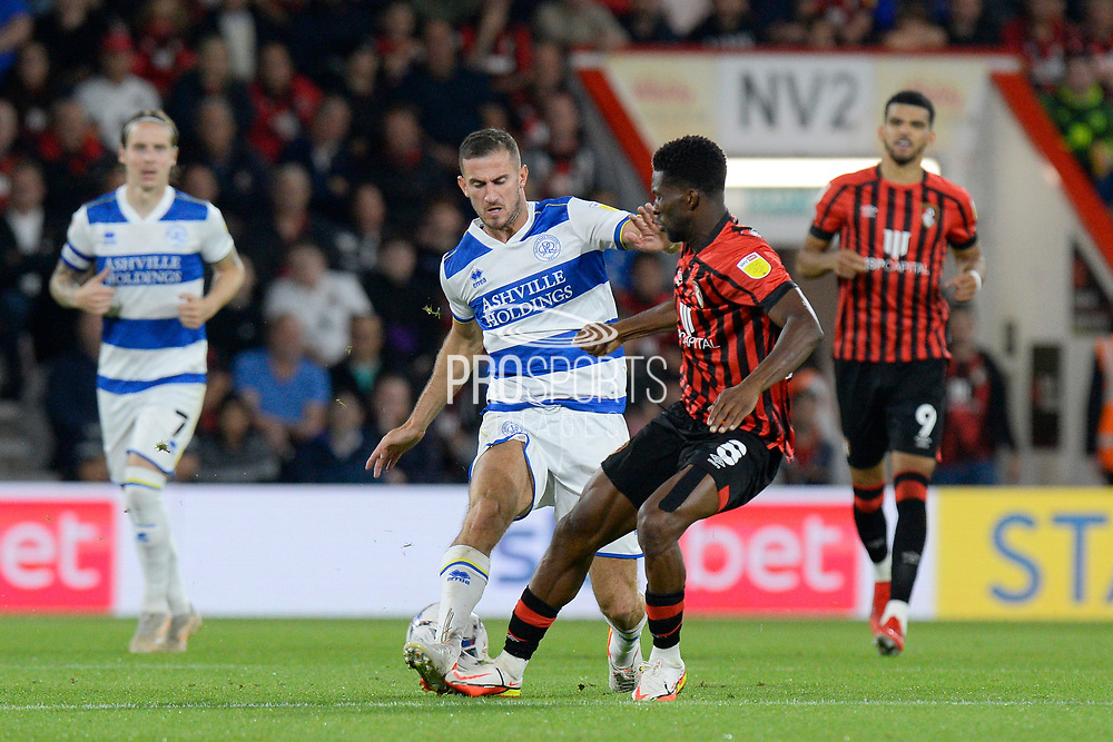 Dominic Ball (12) of Queens Park Rangers battles for possession with Jefferson Lerma (8) of AFC Bournemouth during the EFL Sky Bet Championship match between Bournemouth and Queens Park Rangers at the Vitality Stadium, Bournemouth, England on 14 September 2021.