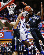Southern Methodist University's Jalen Jones (21) is hammered by Tulsa's Kauri Black (0) during a layup at Moody Coliseum in Dallas, Texas, on January 6, 2013.  (Stan Olszewski/The Dallas Morning News)