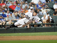 CHICAGO - JUNE 27:  Joe Crede #24 of the Chicago White Sox flies through the air to knock down a line drive during the game against the Chicago Cubs at U.S. Cellular Field in Chicago, Illinois on June 27, 2008.  The White Sox defeated the Cubs 10-3.  (Photo by Ron Vesely)