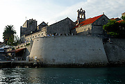 Tower Kula Svih Svetih and outer walls of Korcula old town, Croatia, viewed from the sea.