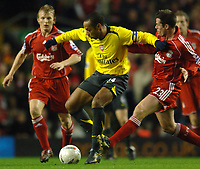 Photo: Paul Greenwood.<br />Liverpool v Arsenal. The FA Cup. 06/01/2007. Arsenal's Thierry Henry, left, holds off Liverpool's Jamie Carragher