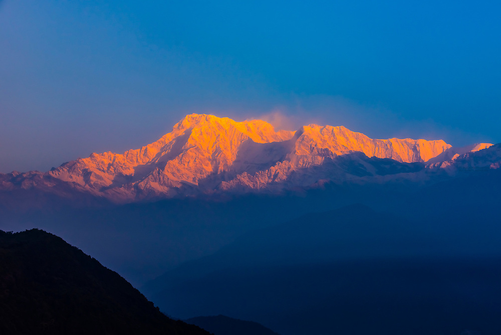 Sunrise on Annapurna South, Annapurna 1 (the 10th highest peak in the world) and Hiunchuli; three of the peaks of the Annapurna Massif (range) in the Himalayas, seen from Sarangkot,  near Pokhara, Nepal.