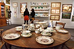 © Licensed to London News Pictures. 26/03/2016. Selection of dining table sets on display. The Duchess of Devonshire press preview at Sotheby's auction house.  The Duchess, Deborah Mitford, was the youngest surviving member of the six Mitford sisters, and died in September 2014. London, UK. Photo credit: Ray Tang/LNP