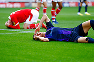 Barnsley defender Liam Lindsay (6) andLuton Town defender Dan Potts (3) lie injured after a clash of heads  during the EFL Sky Bet League 1 match between Barnsley and Luton Town at Oakwell, Barnsley, England on 13 October 2018.