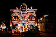 """A few blocks away from the main attractions is this house, with """"Merry Christmas"""" as well as the Greek """"Kala Xpistouyevva"""""""