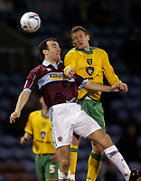 Photo: Jed Wee.<br /> Burnley v Norwich City. Coca Cola Championship. 24/03/2006.<br /> <br /> Norwich's Jonatan Johansson (R) jumps with Burnley's Wade Elliott.