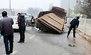 XI'AN, CHINA - DECEMBER 10: (CHINA OUT)<br /> <br /> Truck Gets Stuck As Road Sinks <br /> <br /> Citizens look a truck which is overweight 28 tons of steel plates falling down as the road sinks when passing Hancheng north road on December 10, 2015 in Xi'an, Shaanxi Province of China. The truck was in 12 tons limited while it carried 40 tons of steel plates.<br /> ©Exclusivepix Media