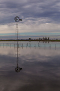 2014/11/21 – Monte Maiz, Argentina: A field where soy is usually planted is flooded after rainfall. Floods are really common nowadays in the region, because the soil can't absorb much water since pesticides make it harder and less absorvent. Another reason is that soy needs less water than other crops, so the water under the soil its just a mere 30cm from the surface making floods common when rainfalls. (Eduardo Leal)