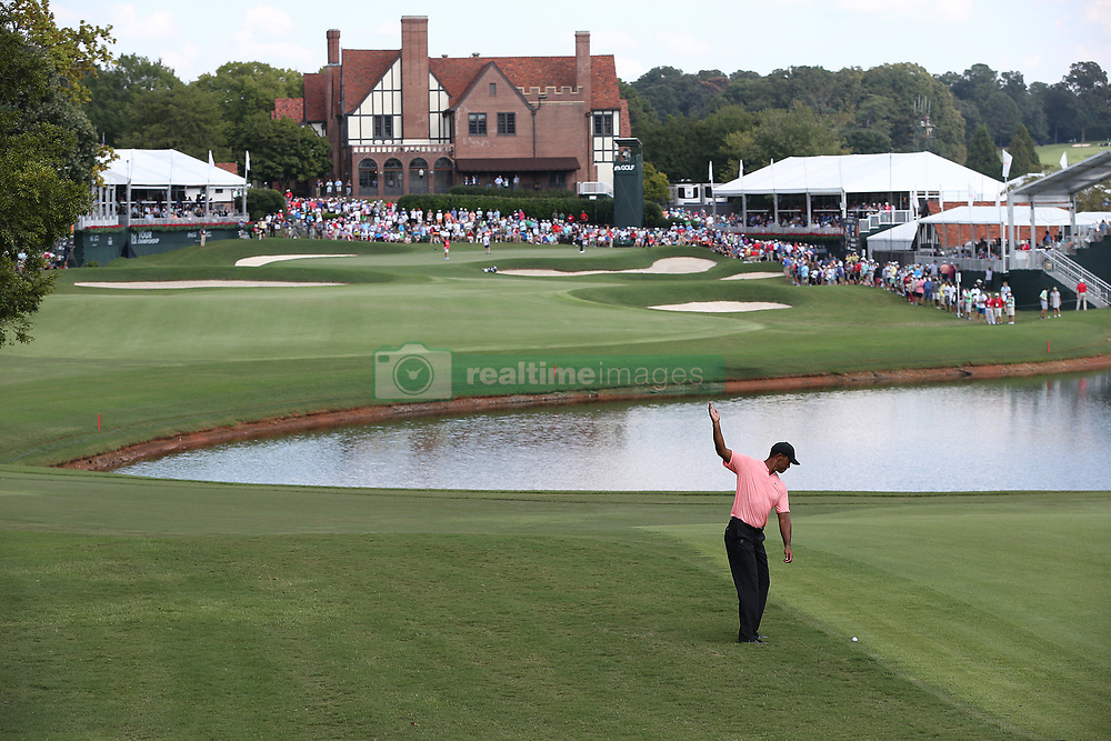 September 20, 2018 - Atlanta, GA, USA - Tiger Woods practices his fairway shot to the 18th green, where he made a birdie to finish 5-under par, during the first round of the Tour Championship on Thursday, Sept. 20, 2018, in Atlanta, Ga. (Credit Image: © Curtis Compton/Atlanta Journal-Constitution/TNS via ZUMA Wire)