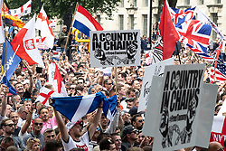 © Licensed to London News Pictures. 09/06/2018. London, UK. 1000s od supporters of EDL founder Tommy Robinson ( real name Stephen Yaxley-Lennon ) on Whitehall during a demonstration in Westminster following Robinson's conviction for Contempt of Court . Robinson was already serving a suspended sentence for Contempt of Court over a similar incident , when he was convicted on Friday 25th May 2018 . Photo credit: Joel Goodman/LNP