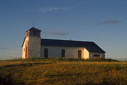 Rural church in New Mexico at sunset