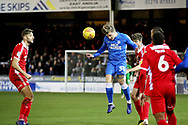 Peterborough Utd forward Jason Cummings (35) with a header during the EFL Sky Bet League 1 match between Peterborough United and Scunthorpe United at London Road, Peterborough, England on 1 January 2019.