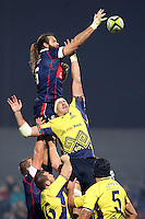 Mihai Macovei (R) of Romania tries to stop  Todd Clever (L) of USA during their  rugby test match, on National Stadium Arc de Triomphe in Bucharest, November 8, 2014.