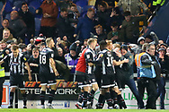 Grimsby Town players celebrate after scoring during the EFL Sky Bet League 2 match between Mansfield Town and Grimsby Town FC at the One Call Stadium, Mansfield, England on 4 January 2020.