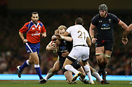 Aled Davies of Wales © is tackled round his neck by Georgia' s Giorgi Begadze (21).  Under Armour 2017 series Autumn international rugby, Wales v Georgia at the Principality Stadium in Cardiff , South Wales on Saturday 18th November 2017. pic by Andrew Orchard, Andrew Orchard sports photography