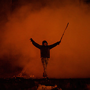 January 24, 2014 - Kiev, Ukraine: A protestor shouts provocative words towards the Ukrainian riot police forces at a defensive barricade near Dynamo Kiev's stadium in central Kiev. (Paulo Nunes dos Santos)