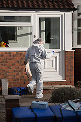 © Licensed to London News Pictures . 17/01/2015 . Stockport , UK . A forensic scenes of crime examiner enters 28 Meadway Road , Cheadle Hulme , Stockport this afternoon (Saturday 17th January 2015 ) after a man and a woman in their 40s were found dead inside last night (16th January 2015) . Photo credit : Joel Goodman/LNP