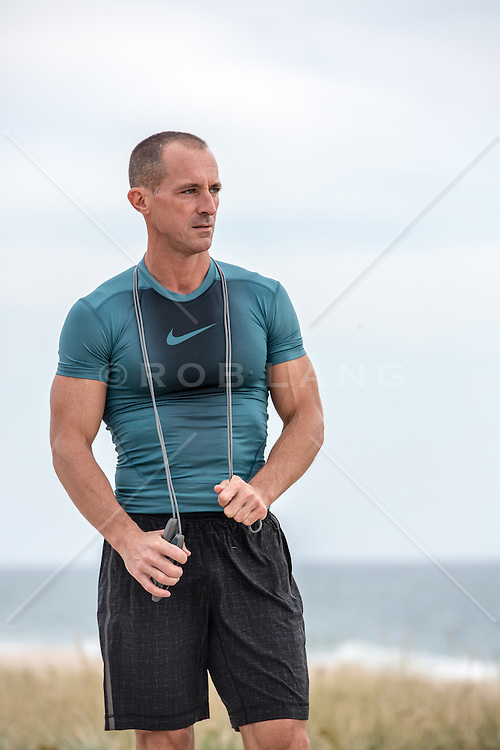 athletic man with a jumprope outdoors