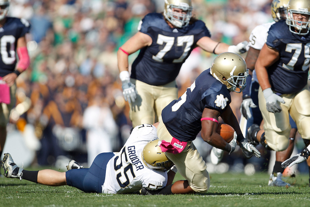 Pittsburgh linebacker Max Gruder (#55) tackles Notre Dame tailback Armando Allen Jr. (#5) during NCAA football game between Pittsburgh and Notre Dame.  The Notre Dame Fighting Irish defeated the Pittsburgh Panthers 23-17 in game at Notre Dame Stadium in South Bend, Indiana.