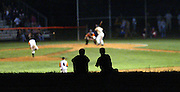 Two boys are silhoetted by the stadium lights while watching the Charlottesville vs Monticello High School match-up at CHS Friday night in Charlottesville, Va. Photo/The Daily Progress/Andrew Shurtleff