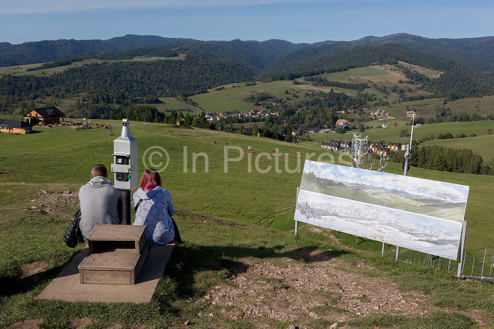 From the viewpoint of the hillside chairlift, a grass meadow landscape, Polish visitors looks down on the Polish village of Jaworki, on 21st September 2019, in Jaworki, near Szczawnica, Malopolska, Poland.