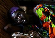 Beatrice Nsabimana, HIV+ and also suffering from malaria, at her home..Service Yezu Mwiza - Gatumba, Burundi