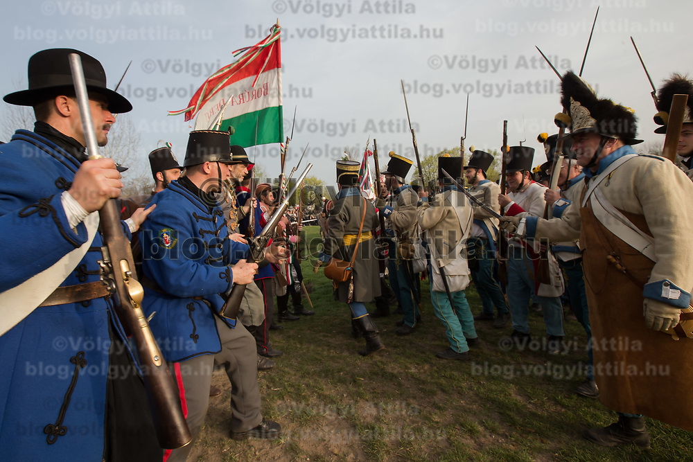 People in period military uniforms re-enact a historic battle in Tapiobicske (some 70 km East from Budapest), Hungary on April 04, 2016. ATTILA VOLGYI