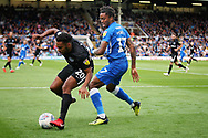 Portsmouth defender Nathan Thompson (20) and Peterborough United forward Ivan Toney (17) tussle during the EFL Sky Bet League 1 match between Peterborough United and Portsmouth at London Road, Peterborough, England on 15 September 2018.