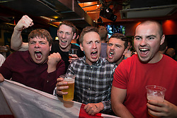 © Licensed to London News Pictures . 14/06/2014 .  Manchester , UK . Football fans in Walkabout in Manchester City Centre this evening (Saturday 14th June 2014) as England play Italy in their first match of the 2014 World Cup , in Brazil . Photo credit : Joel Goodman/LNP
