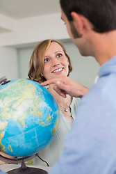 Smiling couple with globe