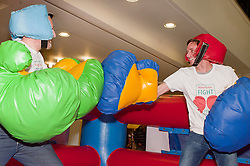 """Dr Rod Lawson Consultant in Respiratory Medicine at Sheffield Teaching Hospitals tries out the inflatable boxing ring at the launch of the """"Winning The Fight For Breath  with COPD Campaign"""" in Meadowhall Shopping Centre Sheffield on Saturday 18th February 2012..www.pauldaviddrabble.co.uk..18th February 2012 -  Image © Paul David Drabble"""