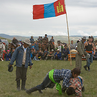 Nomadic herders wrestle at a naadam festival on a remote pass near Muren, Mongolia. This ancient sport is immensely popular across the country and many youngsters do it every day, just for fun.