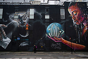 Future mural in Shoreditch in London, United Kingdom. Street art in the East End of London is an ever changing visual enigma, as the artworks constantly change, as councils clean some walls or new works go up in place of others. While some consider this vandalism or graffiti, these artworks are very popular among local people and visitors alike, as a sense of poignancy remains in the work, many of which have subtle messages.
