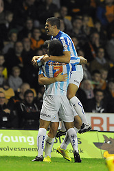 Huddersfield Town's Sean Scannell celebrates with his team mates after scoring. - Photo mandatory by-line: Dougie Allward/JMP - Mobile: 07966 386802 - 01/10/2014 - SPORT - Football - Wolverhampton - Molineux Stadium - Wolverhampton Wonderers v Huddersfield Town - Sky Bet Championship