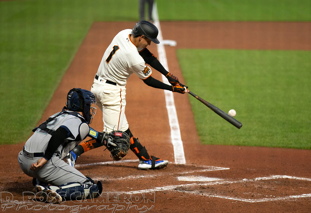 Sep 16, 2020; San Francisco, CA, USA; San Francisco Giants Mauricio Dubón (1) connects for an RBI single against the Seattle Mariners during the second inning of a baseball game at Oracle Park. Mandatory Credit: D. Ross Cameron-USA TODAY Sports