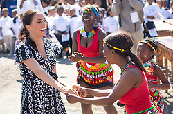 The Duchess of Sussex joins in with dancers as she leaves the Nyanga Township in Cape Town, South Africa, on the first day of their tour of Africa. PA Photo. Picture date: Monday September 23, 2019. See PA story ROYAL Tour . Photo credit should read: Dominic Lipinski/PA Wire