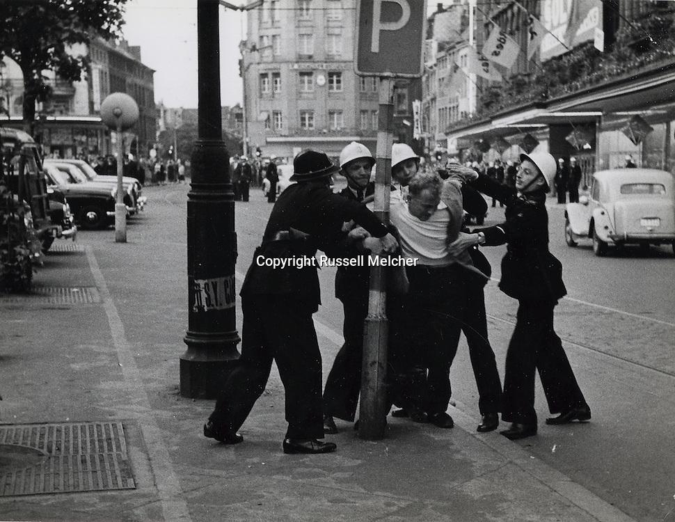Belgium:1956.Police arrest demonstrator<br /> during language fight between French and Flemish demonstrators.<br /> <br /> Belgique: 1956. Policers arretant   des manifestants lors de la lutte de la langue entre les manifestants français et flamands .
