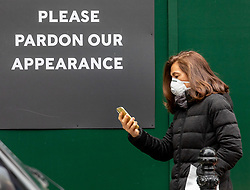 © Licensed to London News Pictures. 13/03/2020. London, UK. A shopper in a mask in Knightsbridge. Knightsbridge appears very quiet this morning as Prime Minister Boris Johnson warned that anyone with cold like symptoms should self-isolate as the World Health Organization declares that the Coronavirus disease is a Pandemic. Photo credit: Alex Lentati/LNP