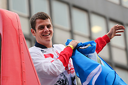 © Licensed to London News Pictures. 28/09/2016. Leeds, UK. onathan Brownlee atop an open top bus does the 'dab' dance move at the Olympic and Paralympic parade in Leeds. Yorkshire's Olympic and Paralympic stars receive a heroes' welcome during an open top bus parade in Leeds, West Yorkshire. . Photo credit : Ian Hinchliffe/LNP