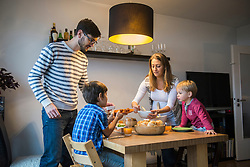 Mother serving food to her family, Munich, Germany