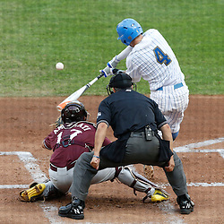 Jun 25, 2013; Omaha, NE, USA; UCLA Bruins right fielder Eric Filia (4) lines out to score center fielder Brian Carroll (24) during the first inning in game 2 of the College World Series finals against Mississippi State Bulldogs catcher Nick Ammirati (17) at TD Ameritrade Park. Mandatory Credit: Derick E. Hingle-USA TODAY Sports