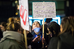 """© Licensed to London News Pictures . 22/02/2018 . Manchester , UK . A woman holds a placard reading """" Girls just wanna have fun-damental human rights """" . 100s of protesters , campaigning against the sexual harassment, abuse, rape and victim-blaming suffered by women, hold a Reclaim the Night march and rally from Owens Park in Fallowfield to the Manchester Academy on Oxford Road . Photo credit : Joel Goodman/LNP"""