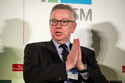 © Licensed to London News Pictures. 08/11/2016. London, UK. Michael Gove MP speaks with The Economist Business Editor Richard Cockett in the closing keynote interview 'Scaling up international growth post-Brexit' at the UK Middle Market Forum. Photo credit : Tom Nicholson/LNP