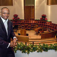 Rev Marcus Cosby the new leader of Wheeler Ave Baptist Church poses in the church will celebrate his first Christmas service as head of the church next Saturday.     (Photo by Kim Christensen)